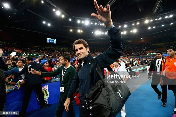 Roger Federer of the Indian Aces waves to the crowd after his victory in his match against Tomas Berdych of the Singapore Slammers during the...