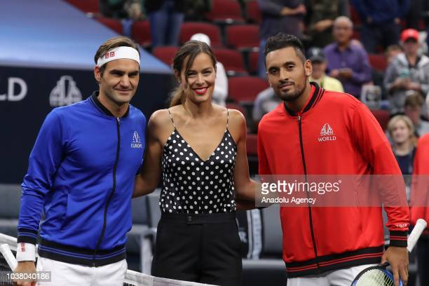 Roger Federer of the Team Europe and Nick Kyrgios of the Team World pose for a photo with former tennis player Ana Ivanovic of Serbia ahead of their...