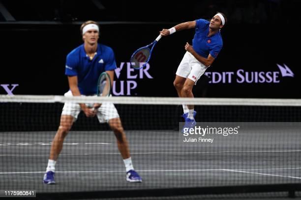 Roger Federer playing partner of Alexander Zverev of Team Europe serves during their doubles match against Jack Sock and Denis Shapovalov of Team...