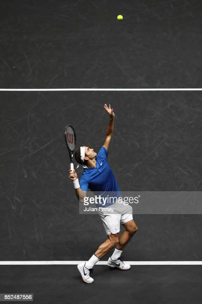 Roger Federer playing with Rafael Nadal of Team Europe serves during there doubles match against Jack Sock and Sam Querrey of Team World on Day 2 of...