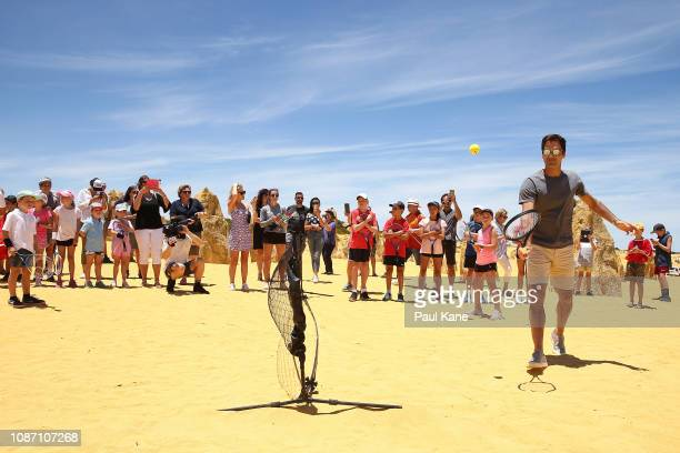 Roger Federer plays tennis with children at the Pinnacles Desert ahead of the 2019 Hopman Cup on December 27 2018 in Cervantes Australia
