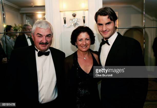 Roger Federer poses for a photo with his mother Lynettee Federer and father Robert Federer as they arrive at the Wimbledon Winners Dinner on July 3...