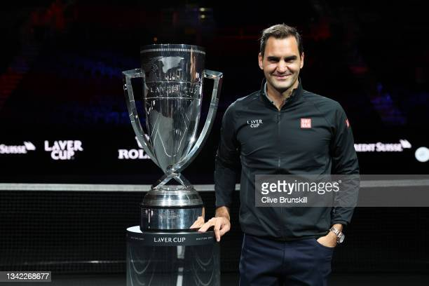 Roger Federer poses for a photograph with the Laver Cup Trophy after taking part in a live TV interview on CNBC at TD Garden on September 24, 2021 in...