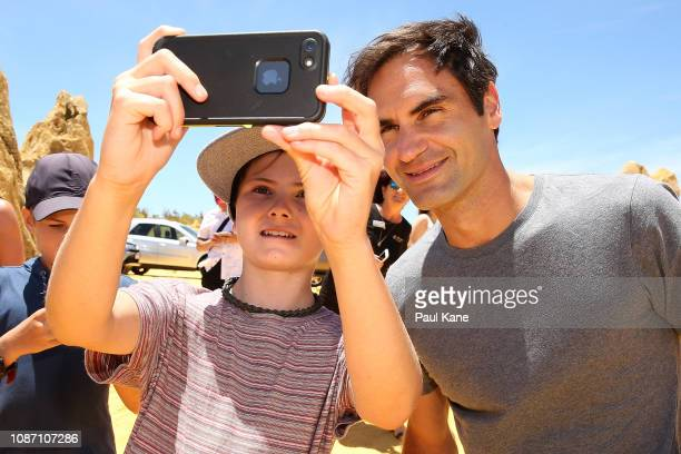 Roger Federer poses for a selfie with a young boy at the Pinnacles Desert ahead of the 2019 Hopman Cup on December 27 2018 in Cervantes Australia