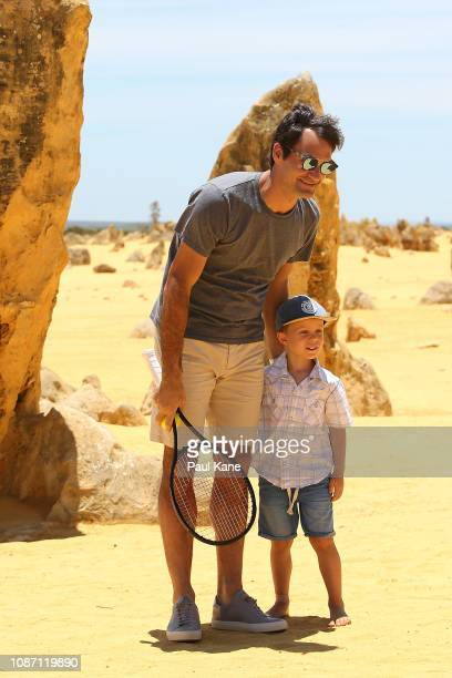 Roger Federer poses with a young boy at the Pinnacles Desert ahead of the 2019 Hopman Cup on December 27 2018 in Cervantes Australia