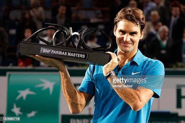 Roger Federer poses with his trophy after winning the 'BNP Paribas' Tennis Masters Final in Bercy at Palais Omnisports de Bercy on November 13, 2011...