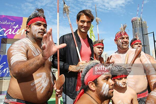 Roger Federer poses with representatives of the indigenous Mirrabooka tribe after a traditional Welcome to Country ceremony at South Bank ahead of...
