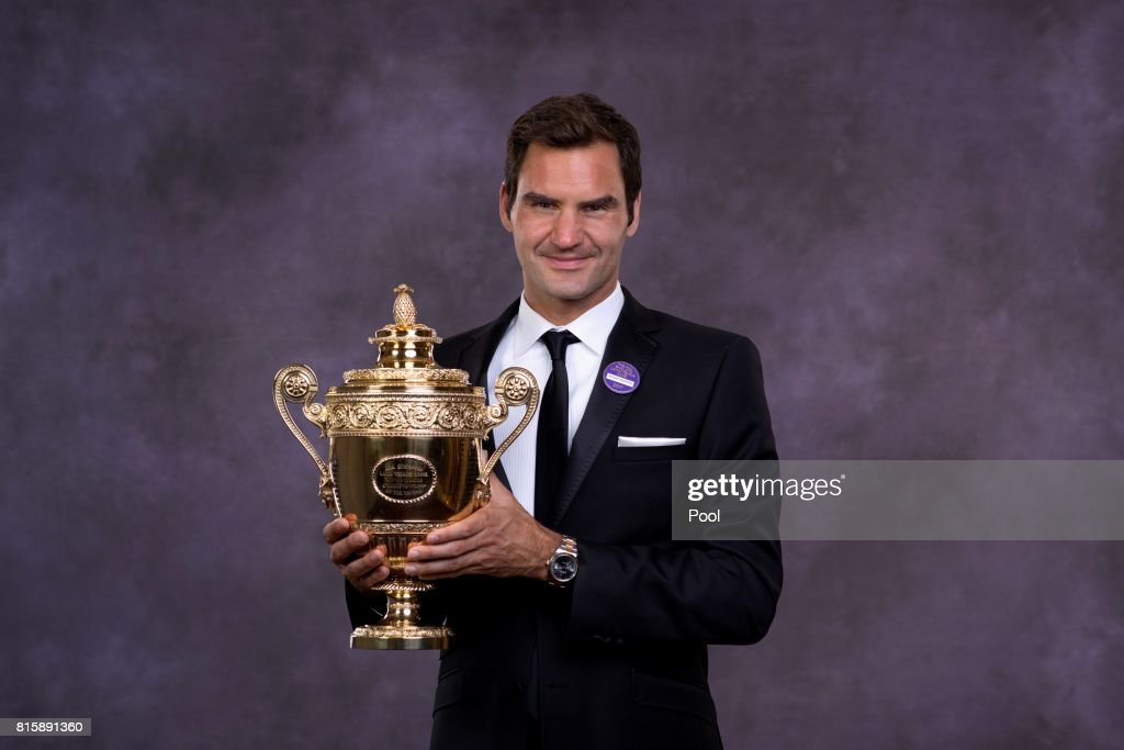Roger Federer poses with the trophy at the Wimbledon Winners Dinner at The Guildhall on July 16, 2017 in London, England.