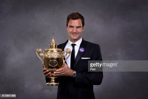 Roger Federer poses with the trophy at the Wimbledon Winners Dinner at The Guildhall on July 16 2017 in London England