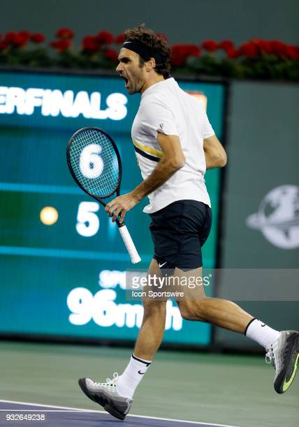 Roger Federer reacts after winning a set during the quarterfinals of the BNP Paribas Open on March 15 at the Indian Wells Tennis Gardens in Indian...