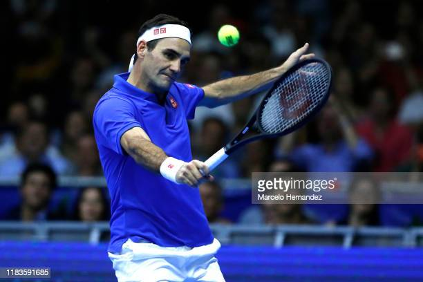 Roger Federer return the ball to Alexander Zverev during an exhibition game between Roger Federer and Alexander Zverev at Movistar Arena on November...