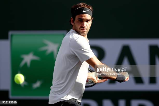Roger Federer returns a shot against Jeremy Chardy of France during the BNP Paribas Open at the Indian Wells Tennis Garden on March 14 2018 in Indian...