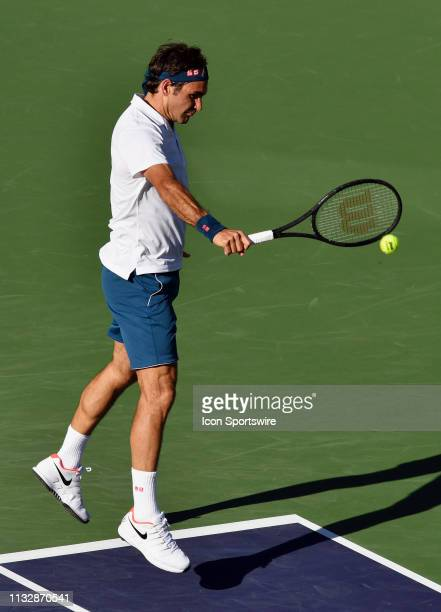 Roger Federer returns a shot in a finals match during the BNP Paribas Open played on March 17 2019 at the Indian Wells Tennis Garden in Indian Wells...