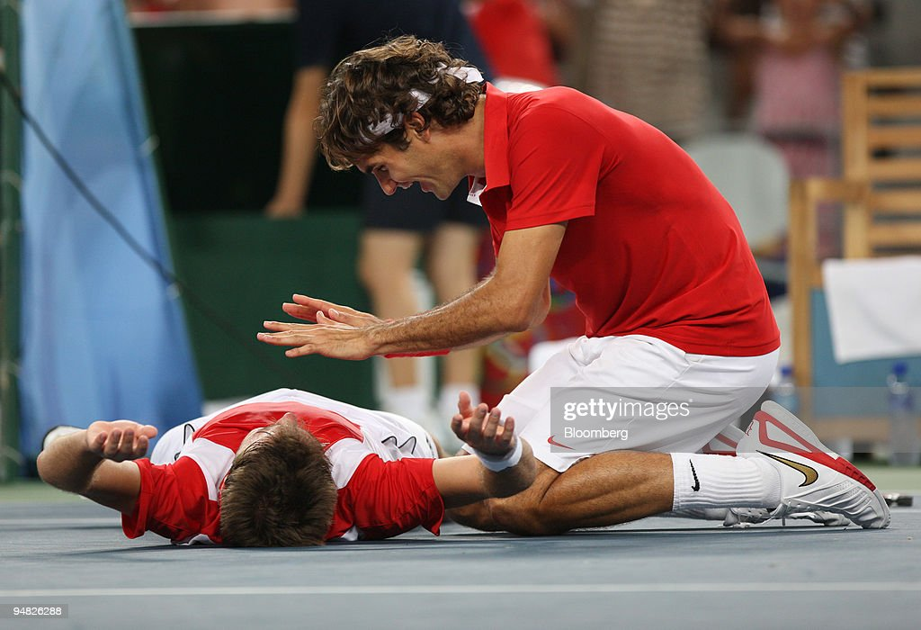 Roger Federer, right, and Stanislas Wawrinka, both of Switze : News Photo