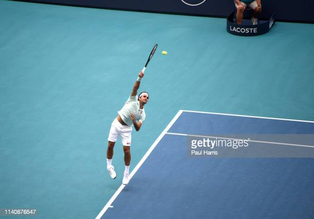 Roger Federer serves during a match 2019 is the first year that the Miami Open Tennis tournament was held at the Hard Rock Stadium which is also the...