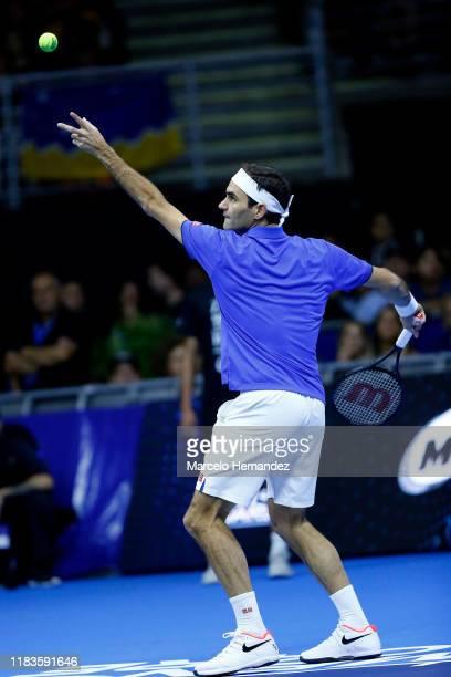 Roger Federer serves the ball to Alexander Zverev during an exhibition game between Roger Federer and Alexander Zverev at Movistar Arena on November...