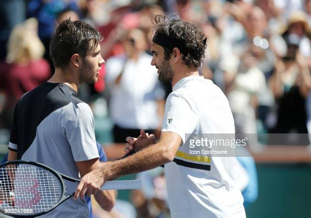 Roger Federer shakes hands with Borna Coric after a semifinals match of the BNP Paribas Open on March 17 at the Indian Wells Tennis Gardens in Indian...