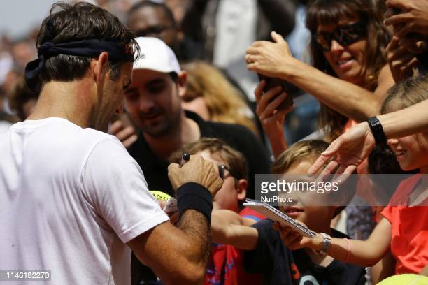 Roger Federer signing autographs for his fans in Suzanne Lenglen court during Roland Garros kids day on May 25 2019 in Paris France