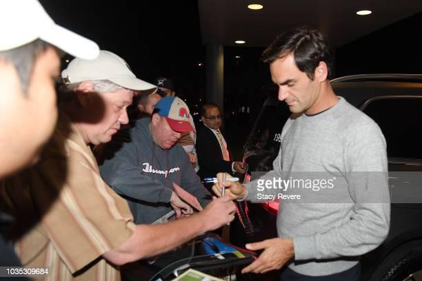 Roger Federer signs autographs for fans after arriving for Laver Cup 2018 on September 18 2018 in Chicago Illinois