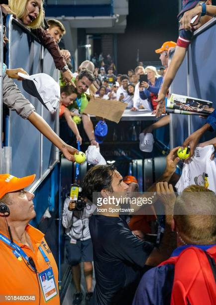 Roger Federer signs autographs for fans after defeating Stan Wawrinka during the Western Southern Open at the Lindner Family Tennis Center in Mason...