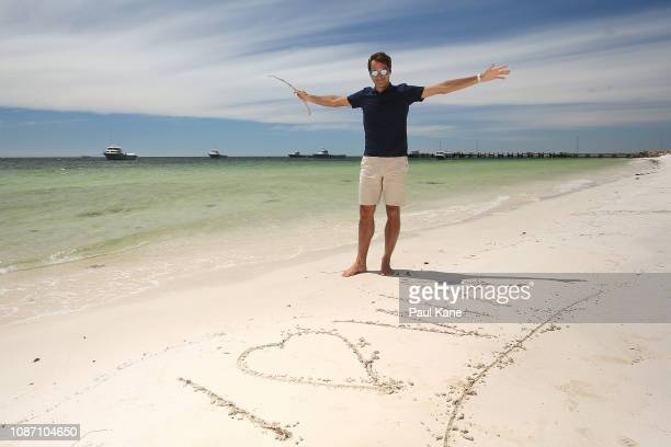 Roger Federer signs I Love WA on the beach ahead of the 2019 Hopman Cup at The Lobster Shack on December 27 2018 in Cervantes Australia