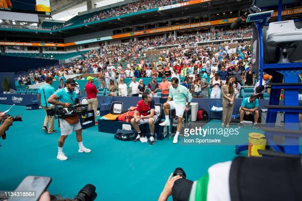 Roger Federer speaks to John Isner after the Mens Final of the Miami Open on March 31 2019 at Hard Rock Stadium in Miami Gardens FL