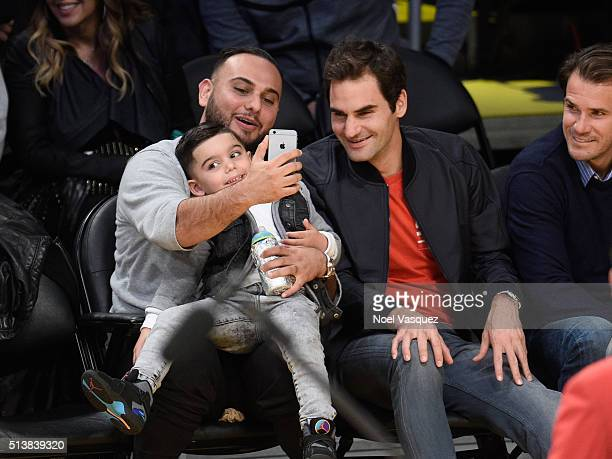 Roger Federer takes a selfie with a fan at a basketball game between the Atlanta Hawks and the Los Angeles Lakers at Staples Center on March 4 2016...