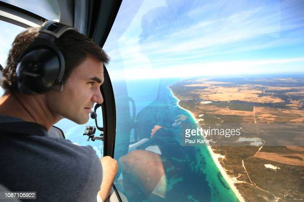 Roger Federer takes in the vista of the Western Australian coastline from the helicopter enroutre to the Pinnacles Desert ahead of the 2019 Hopman...
