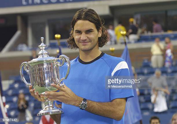 Roger Federer wins the men's singles final September 12 2004 at the 2004 US Open in New York and holds the champions trophy