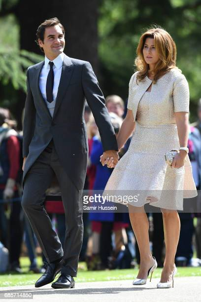 Roger Federer with wife Mirka Federer attends the wedding of Pippa Middleton and James Matthews at St Mark's Church on May 20 2017 in Englefield...