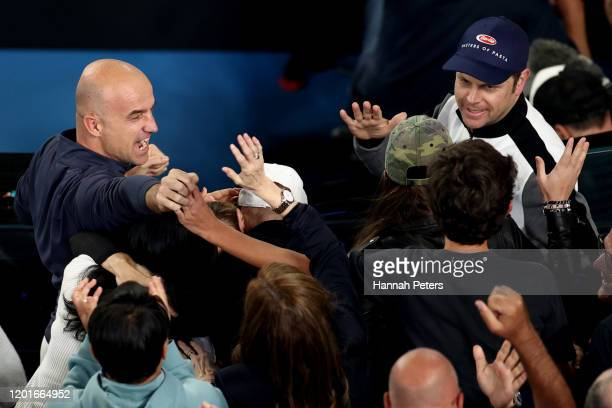 Roger Federer's coach Ivan Ljubicic celebrates after the Men's Singles third round match against John Millman of Australia on day five of the 2020...