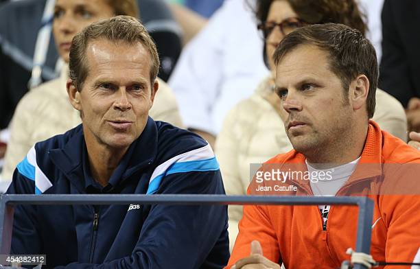 Roger Federer's coaches Stefan Edberg and Severin Luthi attend his match on Day 5 of the 2014 US Open at USTA Billie Jean King National Tennis Center...