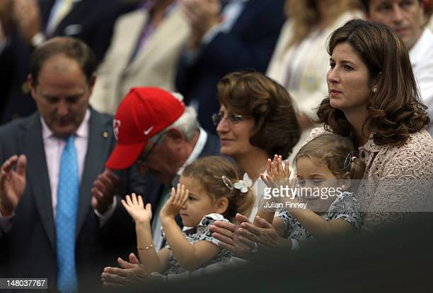 Roger Federer's dad Roger Federer wife Miroslava Vavrinec and daughters Myla Rose and Charlene Riva celebrate after Roger he won his Gentlemen's...