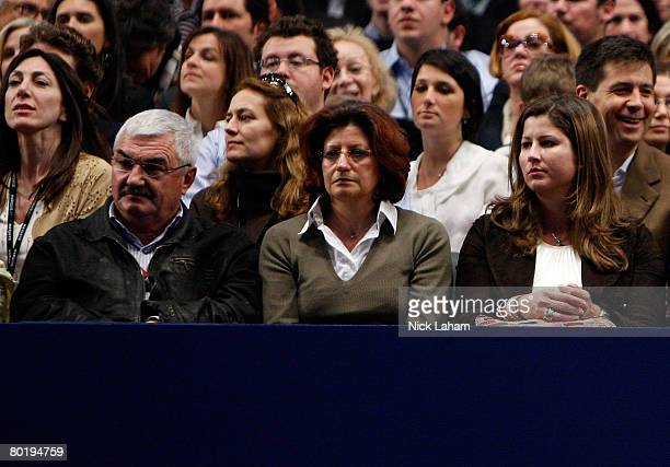 Roger Federer's father Robert mother Lynettee and girlfriend Mirka Vavrinec watch as Pete Sampras and Federer play during their exhibition match on...