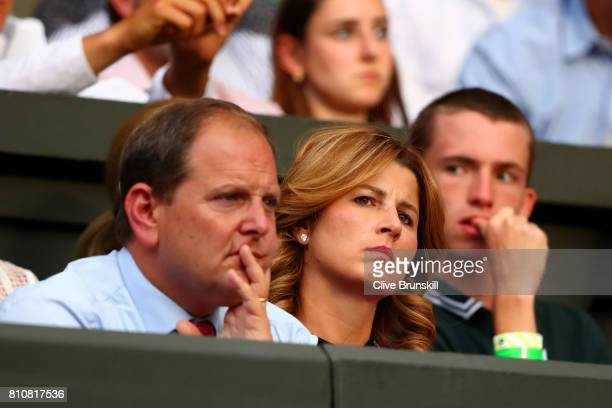 Roger Federer's wife Mirka and agent Tony Godsick look on during the Gentlemen's Singles third round match between Roger Federer of Switzerland and...
