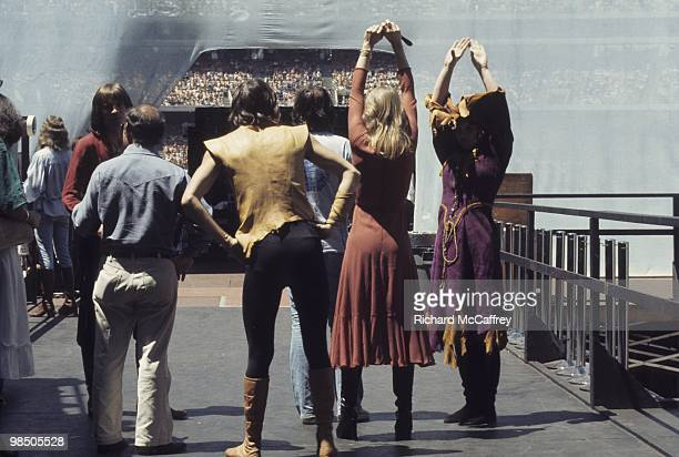 Roger Fisher and Nancy and Ann Wilson of Heart prepare to go onstage at The Oakland Coliseum in 1977 in Oakland California