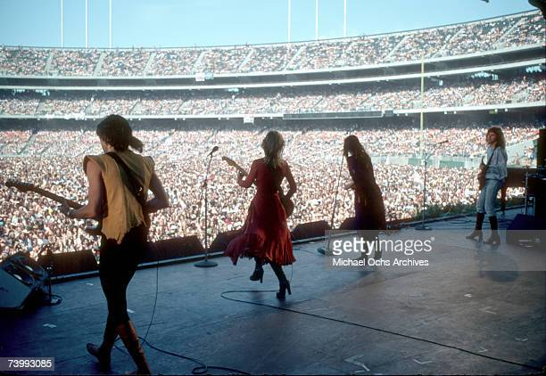 """Roger Fisher, Nancy Wilson, Ann Wilson and Howard Leese of the rock band """"Heart"""" perform onstage at the Oakland Coliseum on May 30, 1977 in Oakland,..."""