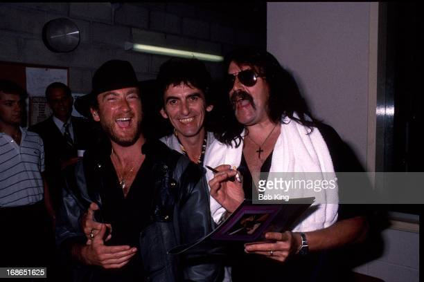 Roger Glover and Jon Lord of Deep Purple backstage with George Harrison on Deep Purple's Perfect Strangers World Tour at the Entertainment Centre...