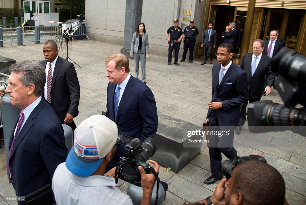 Roger Goodell, commissioner of the National Football League (NFL), center, exits federal court in New York, U.S. on Monday, Aug. 31, 2015. New England Patriots quarterback Tom Brady and Goodell will find out this week whether a judge upholds Brady's four-game suspension relating to having used deflated footballs in a playoff game last year. Photographer: Michael Nagle/Bloomberg via Getty Images