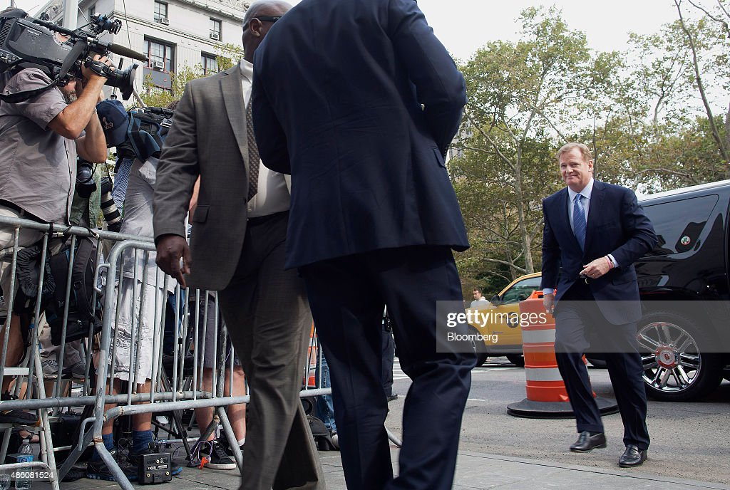 Roger Goodell, commissioner of the National Football League (NFL), right, arrives at federal court in New York, U.S., on Monday, Aug. 31, 2015. New England Patriots Quarterback Tom Brady was suspended for four games after the NFL concluded he was probably aware that team employees deflated game balls below the minimum air pressure to give him an advantage last season's conference championship game. The league sued July 28 to confirm Brady's suspension. The players association filed its own suit to reverse it. Photographer: Michael Nagle/Bloomberg via Getty Images