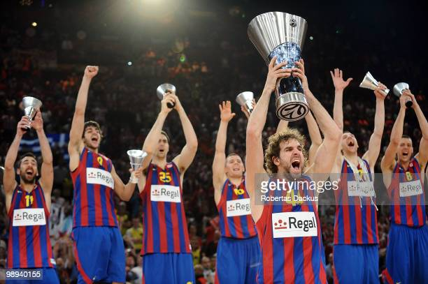 Roger Grimau and Regal FC Barcelona players celebrate with their trophies during the 2009-2010 Euroleague Basketball Champion Awards Ceremony at...