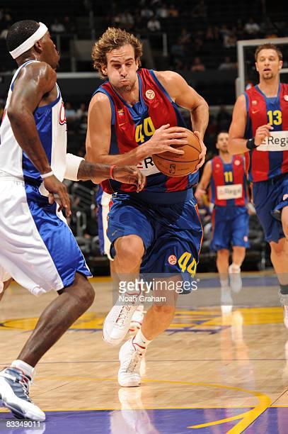 Roger Grimau Gragera of Regal FC Barcelona gets through the lane against Ricky Davis of the Los Angeles Clippers at Staples Center on October 19 2008...
