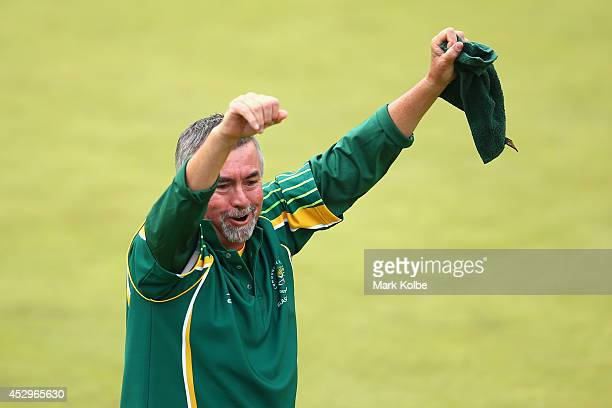 Roger Hagerty of South Africa celebrates their gold medal victory in the Para-Sport Open Triples B6/B7/B8 lawn bowls at Kelvingrove Lawn Bowls Centre...