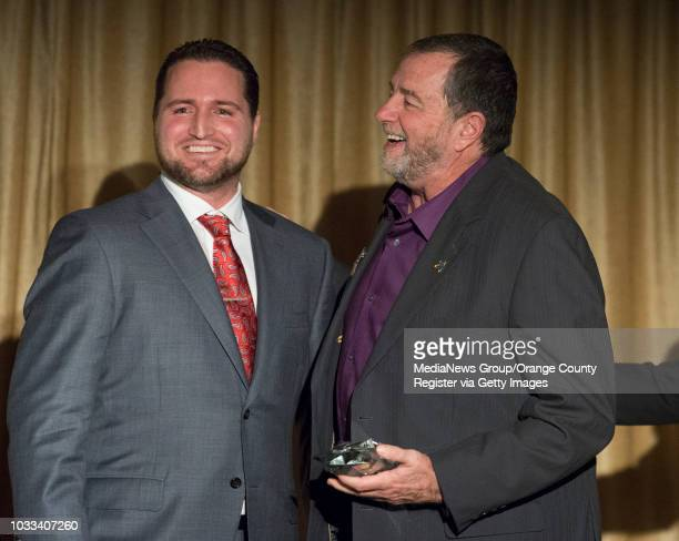 Roger Hogan Jr left general manager of Capistrano Toyota shares in the excitement after presenting Jim Carson right of the Orangewood Children's...