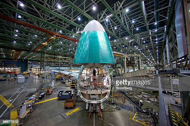 Roger Howe calibrates flight controls in the nose of a Boeing 7478 cargo plane during final assembly in Everett Washington US on Tuesday March 16...