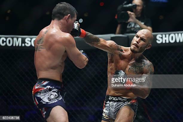 Roger Huerta of United States of America fights Adrian Pang of Australia for the men's lightweight bout during One Championship: Defending Honor at...