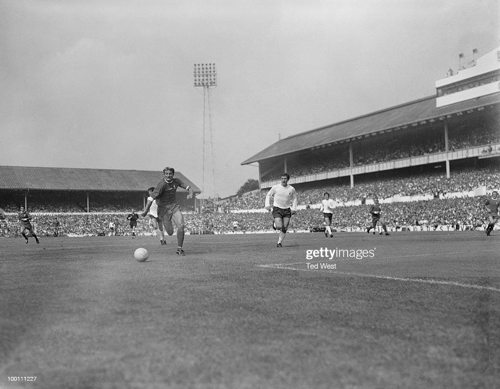 Roger Hunt of Liverpool (left) in action against Tottenham Hotspur, 1969.