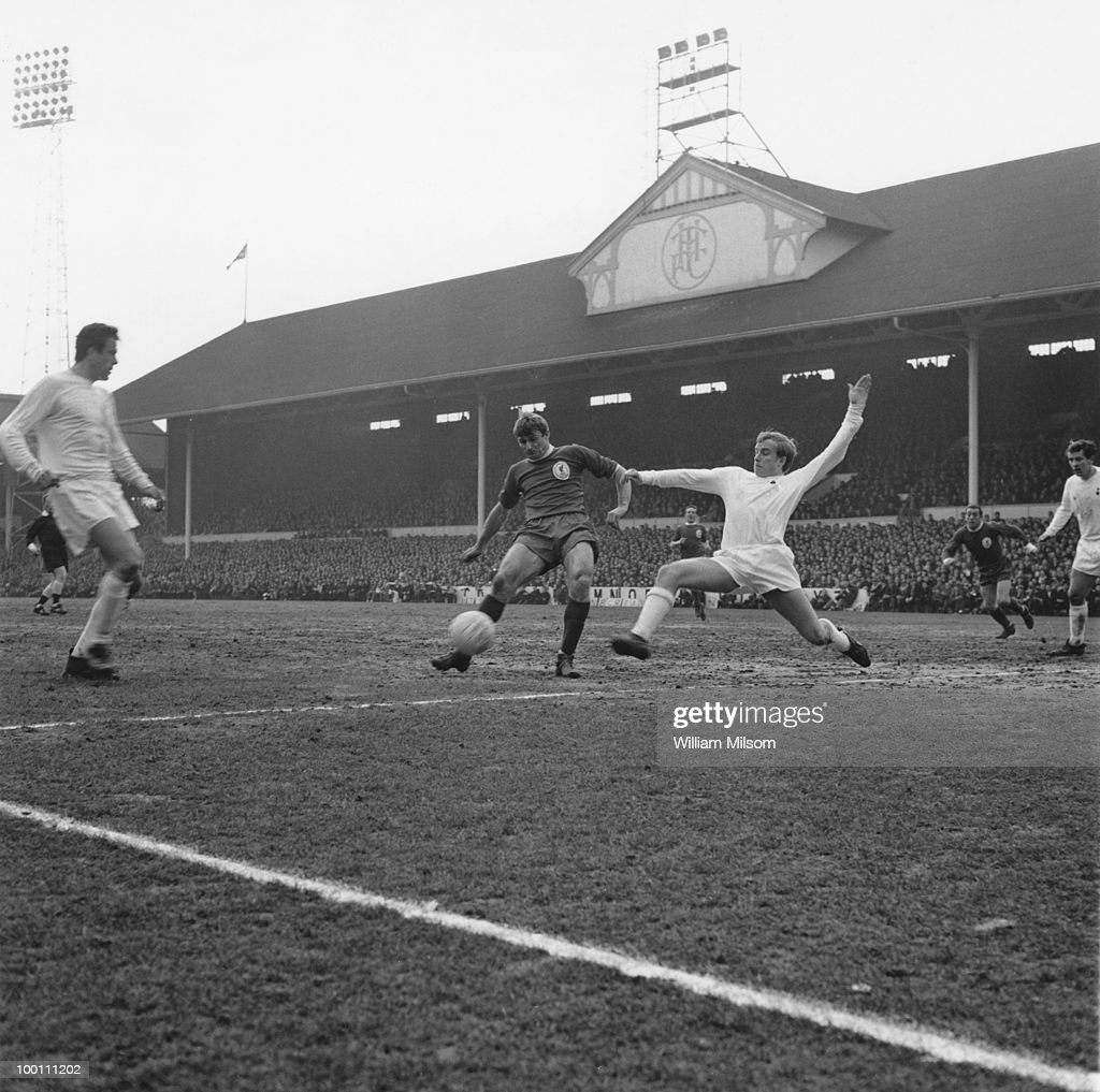 Roger Hunt (centre) of Liverpool is tackled by Phil Beal of Tottenham Hotspur during an FA Cup Fifth Round match at White Hart Lane, London, 9th March 1968. The match ended in a 1-1 draw.
