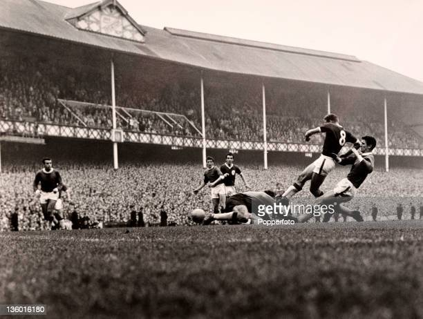 Roger Hunt shoots past Everton goalkeeper Gordon West to score a dramatic equaliser for Liverpool during their Division One match at Goodison Park in...