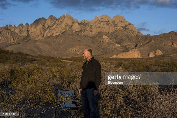 Roger Hunter chief technology officer for QTS Capital Management LLC stands for a photograph in the foothills of the Organ Mountains in Las Cruces...